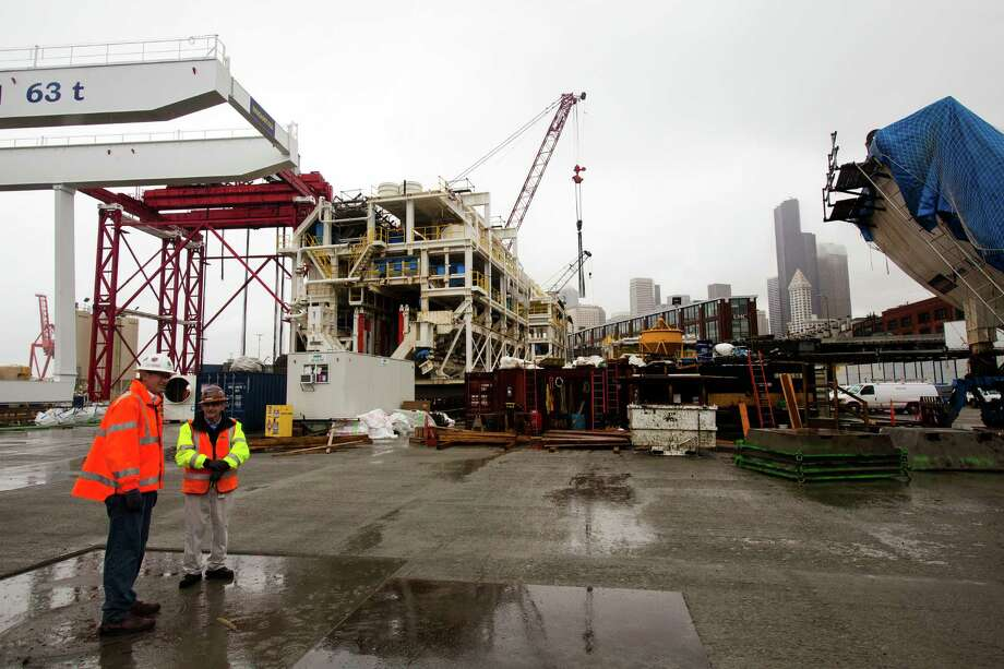 WSDOT officials lead a guided tour of the Alaskan Way Viaduct Replacement program's progress at the site of the Bertha SR 99 tunneling machine and launch point Friday west of CenturyLink Field in Seattle. The 41 pieces that make up the drill have been unloaded from the Jumbo Fairpartner and are now stored around the site. Later this month, crews will begin lowering the pieces into the launch pit for reassembly and testing. Photo: JORDAN STEAD, SEATTLEPI.COM / SEATTLEPI.COM