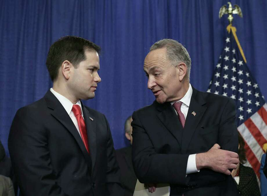 Sen. Chuck Schumer (right), D-N.Y., rightly recognized the importance of keeping Sen. Marco Rubio on board with legislation that creates amnesty for immigrants. Schumer earned Rubio's respect while selling him a lopsided deal. Photo: Alex Wong / Getty Images