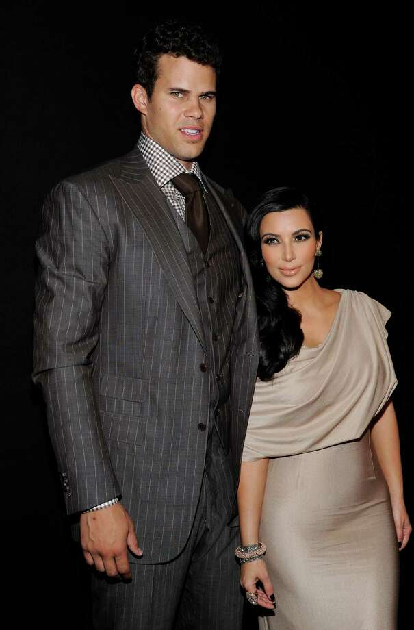 FILE - This Aug. 31, 2011 file photo shows newlyweds Kim Kardashian and Kris Humphries attending a party thrown in their honor at Capitale in New York. A Los Angeles judge has approved a divorce settlement between Kim Kardashian and Kris Humphries. Details of the agreement were not disclosed in a brief court hearing Friday, April 19, 2013, but the judge said he felt that settlement talks had led to resolution. The divorce will become final once papers are prepared and signed by the parties. Kardashian and Humphries were married in August 2011.  She filed for divorce in October 2011. (AP Photo/Evan Agostini, file) Photo: Evan Agostini