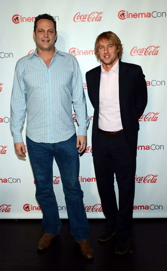 Actors Vince Vaughn (L) and Owen Wilson, recipients of the Comedy Duo of the Year Award, arrive at the CinemaCon awards ceremony at the Pure Nightclub at Caesars Palace during CinemaCon, the official convention of the National Association of Theatre Owners, on April 18, 2013 in Las Vegas, Nevada.