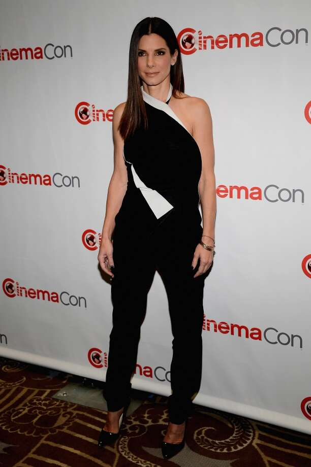 "Actress Sandra Bullock arrives at a Twentieth Century Fox presentation to promote the upcoming film ""The Heat\"" at Caesars Palace during CinemaCon, the official convention of the National Association of Theatre Owners, on April 18, 2013 in Las Vegas, Nevada."