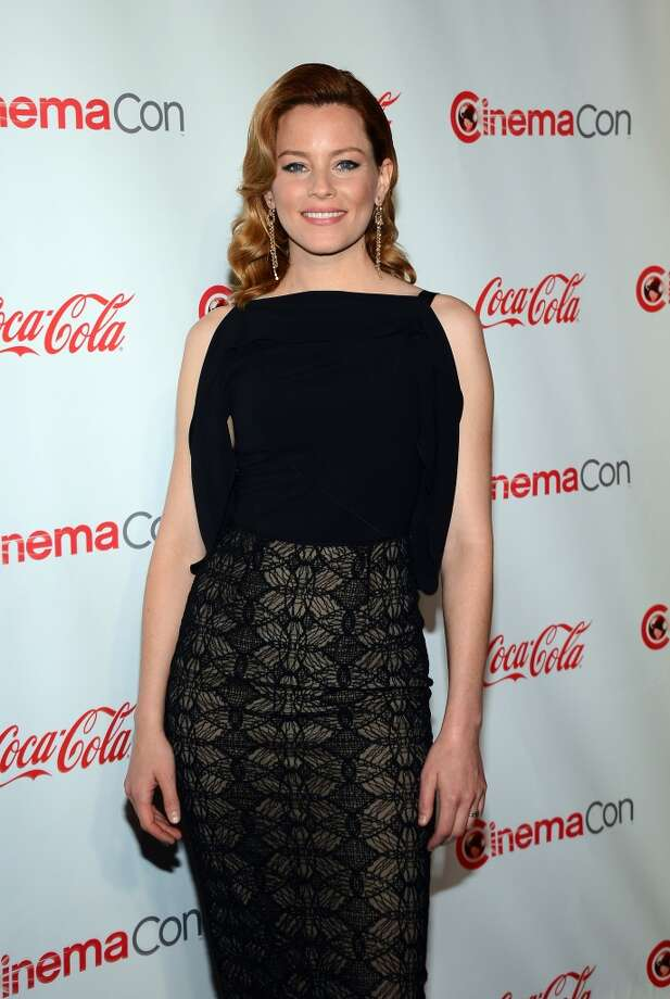 Actress Elizabeth Banks, recipient of the Award of Excellence in Acting, arrives at the CinemaCon awards ceremony at the Pure Nightclub at Caesars Palace during CinemaCon, the official convention of the National Association of Theatre Owners, on April 18, 2013 in Las Vegas, Nevada.