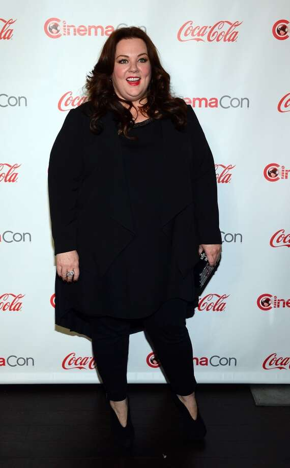 Actress Melissa McCarthy, recipient of the Female Star of the Year Award, arrives at the CinemaCon awards ceremony at the Pure Nightclub at Caesars Palace during CinemaCon, the official convention of the National Association of Theatre Owners, on April 18, 2013 in Las Vegas, Nevada.