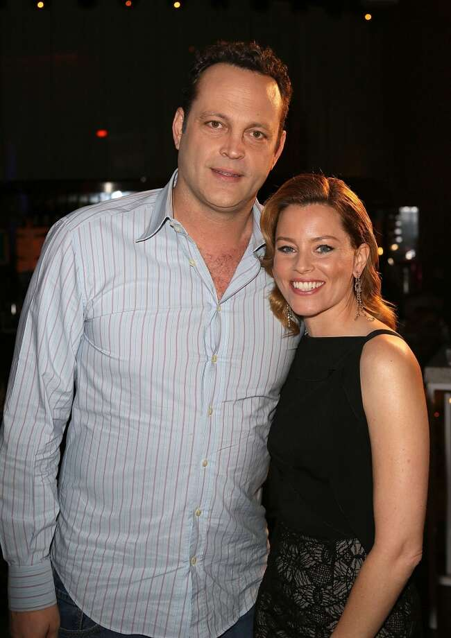 Actor Vince Vaughn (L) co-recipient of the Comedy Duo of the Year award, and actress Elizabeth Banks, recipient of the Award of Excellence in Acting, attend the CinemaCon 2013 Final Night Awards at Caesars Palace during CinemaCon, the official convention of the National Association of Theatre Owners on April 18, 2013 in Las Vegas, Nevada.