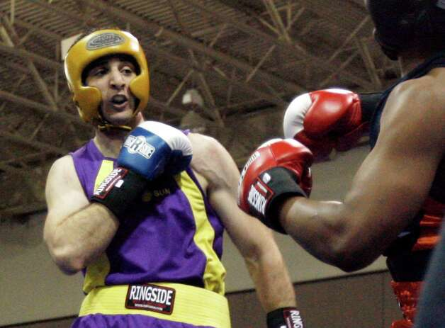 FILE - In this May 4, 2009 file photo,  Tamerlan Tsameav, left, fights Lamar Fenner of Chicago, in the 201 weight class, during the 2009 Golden Gloves National Boxing Tournament at the Salt Palace, Monday, May 4,  2009. Tsameav was identified as a suspect in the Boston Marathon bombings.  Tsarnaev, who had been known to the FBI as Suspect No. 1 and was seen in surveillance footage in a black baseball cap, was killed overnight Thursday during a getaway attempt, officials said. On Friday, April 19, 2013, thousands of officers were swarming the streets in and around Boston hunting for Tsarnaev's younger brother, Dzhokhar Tsarnaev, 19. (AP Photo/The Salt Lake Tribune, Rick Egan)  DESERET NEWS OUT; LOCAL TV OUT; MAGS OUT Photo: Associated Press