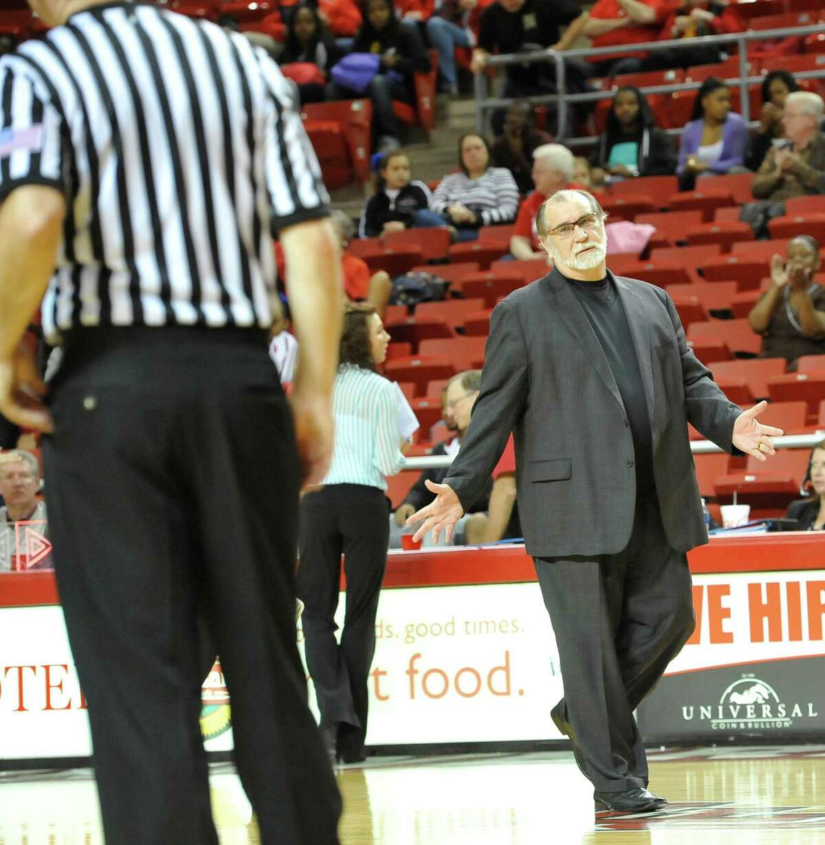 Head Coach Larry Tidwell, right, gestures to a referee as he leaves the court after the first half of the game. The Lamar University Lady Cardinals tipped off at 5:30 p.m. against the Northwestern State Lady Demons Thursday night. Dave Ryan/The Enterprise