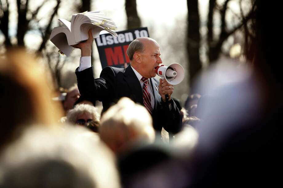 "WASHINGTON - MARCH 16:  Rep. Louie Gohmert (R-TX) holds up a copy of proposed health care reform legislation during a ""CODE RED"" rally in opposition to the health care reform bill on Capitol Hill  March 16, 2010 in Washington, DC. Sponsored by The American Grass Roots Coalition and the Tea Party Express, the rally focused attention and opposition to the congressional Democrats' efforts to push through a final vote on health care reform by the end of the week.  (Photo by Chip Somodevilla/Getty Images) Photo: Chip Somodevilla, Getty Images / Getty Images North America"