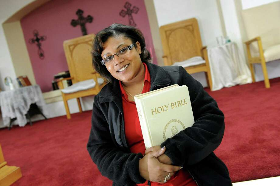 Denise Ramos, who recently completed a Bible study course with Pastor Willie Bacote, on Tuesday, April 16, 2013, at Missing Link AME Zion Church in Lansingburgh, N.Y.  (Cindy Schultz / Times Union) Photo: Cindy Schultz / 10021968A