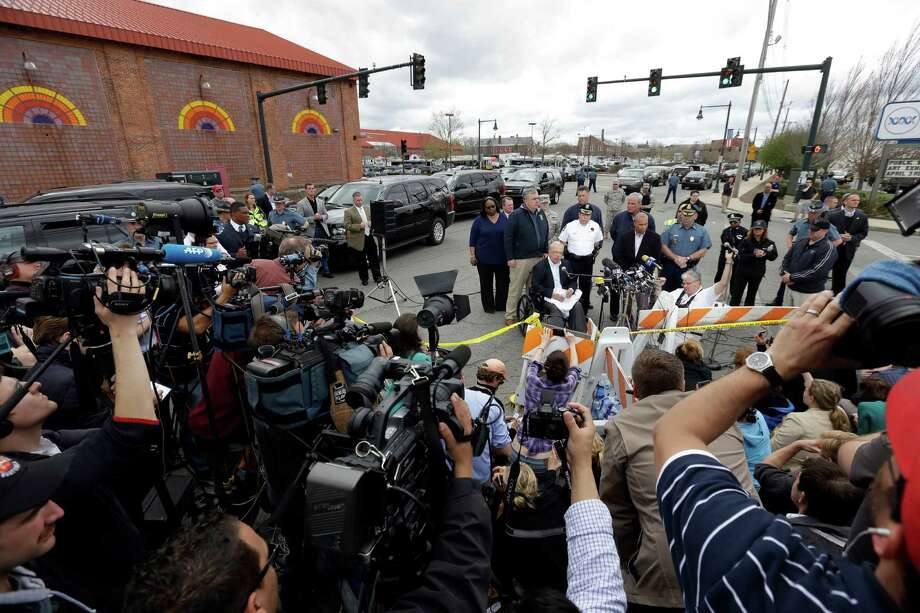 Media gather Friday morning in the Watertown, Mass., area for an official update about the search for the surviving Boston Marathon bombing suspect. Photo: Matt Rourke, STF / AP