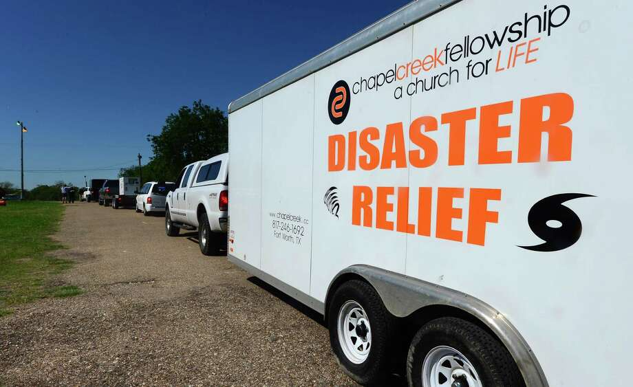 Vehicles wait in line while headed to a distribution center where supplies like water and clothing, including medical supplies, are being dropped off or picked up as needed, in West, Texas, on April 19 2013, two days after a deadly fertilizer plant blast occured.  While rescuers in Texas were set to return to the rubble in their continuing search for survivors after the massive blast killed as many as 15 people and destroyed dozens of homes, all roads leading to the area of destruction have been closed off and manned by various state authorities controlling the entry and exit of vehicles and people.AFP PHOTO/Frederic J. BROWNFREDERIC J. BROWN/AFP/Getty Images Photo: FREDERIC J. BROWN, AFP/Getty Images / AFP