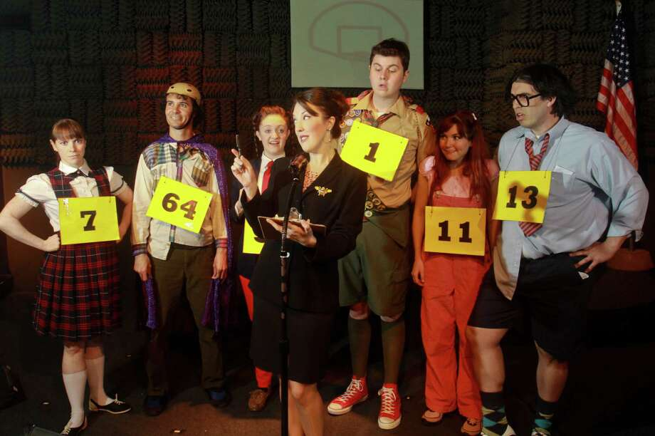 "(For the Chronicle/Gary Fountain, April 8, 2013) Kristina Sullivan as Rona Lisa Perretti, foreground, with Beth Lazarou as Marcy Park, background, from left, Braden Hunt as Leaf Coneybear, Martha Patton as Logan Schwartzandgrubenniere, Marco Camacho as Chip Tolentino, Cay Taylor as Olive Ostrovsky, and Rick Evans as William Barfee, in this scene from ""The 25th Annual Putnam County Spelling Bee"" at Music box Theater. Photo: Gary Fountain, Freelance / Copyright 2013 Gary Fountain"