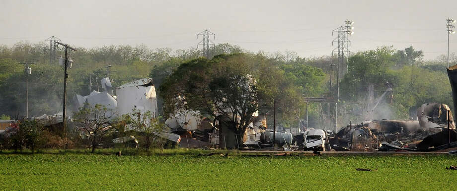Mangled debris of a fertilizer plant are seen Thursday, April 18, 2013, a day after an explosion leveled the plant in West, Texas. The massive explosion at the West Fertilizer Co. Wednesday night killed as many as 15 people and injured more than 160. (AP Photo/The Times, Henrietta Wildsmith) Photo: Henrietta Wildsmith/The Times, MBO / Shreveport Times
