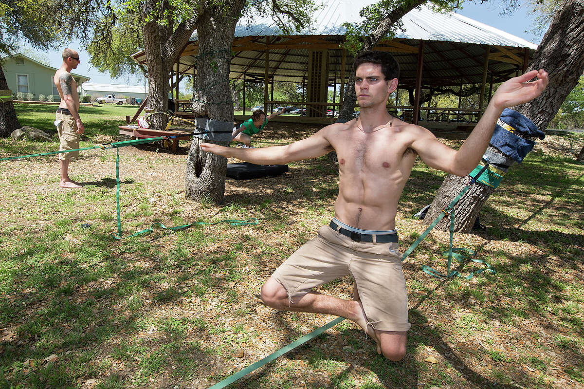 FOR FEATURES - Austin White keeps his composure while slacklining at Stunt Ranch in Dripping Springs on Sunday, April 14, 2013. MICHAEL MILLER / FOR THE EXPRESS-NEWS