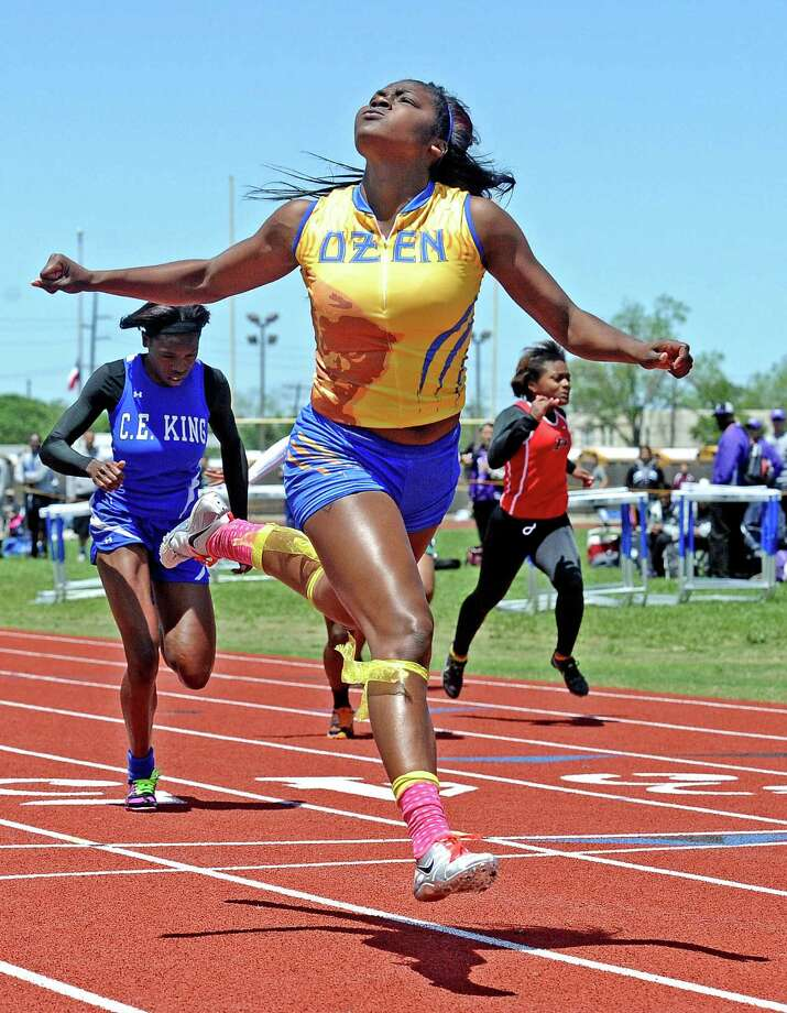 Ozen athlete Bealoved Brown takes the win in the girls 100 meter dash during the 4A area track meet at Babe Zaharias Stadium on Friday, April 19, 2013. Photo taken: Randy Edwards/The Enterprise Photo: Randy Edwards