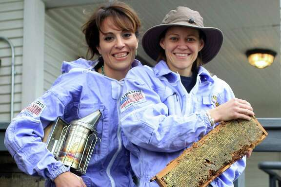Dalia, left, and Jamie Zelko launched the Heights Honeybee Project after watching a documentary about the loss of honeybees. The couple now has 89 hives in Houston and Alvin.