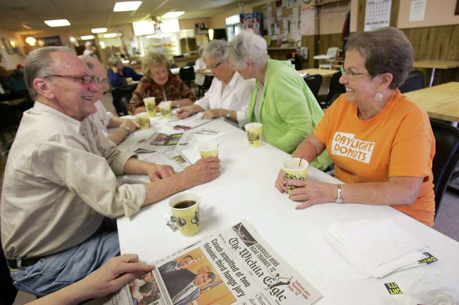 Residents gather at Daylight Donuts in Wellington, Kan., to discuss the day's happenings. The consensus among the clientele is that the federal government is too big, but their area benefits from it in many ways. Photo: David Pulliam, MBR / Kansas City Star