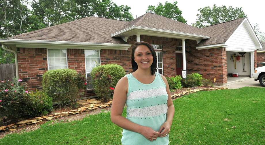 Outside her first home, Zuhra Haynes, talks about what it was like filming for the show as she stands in her front yard Friday April 18, 2013. Zuhra and Kellen Haynes  will be featured on a reality television show, My First Home, which airs on The Learning Channel, April 20, 2013 at 11a.m. Their new  home is off Major on Hidden Valley Drive. Dave Ryan/The Enterprise Photo: Dave Ryan