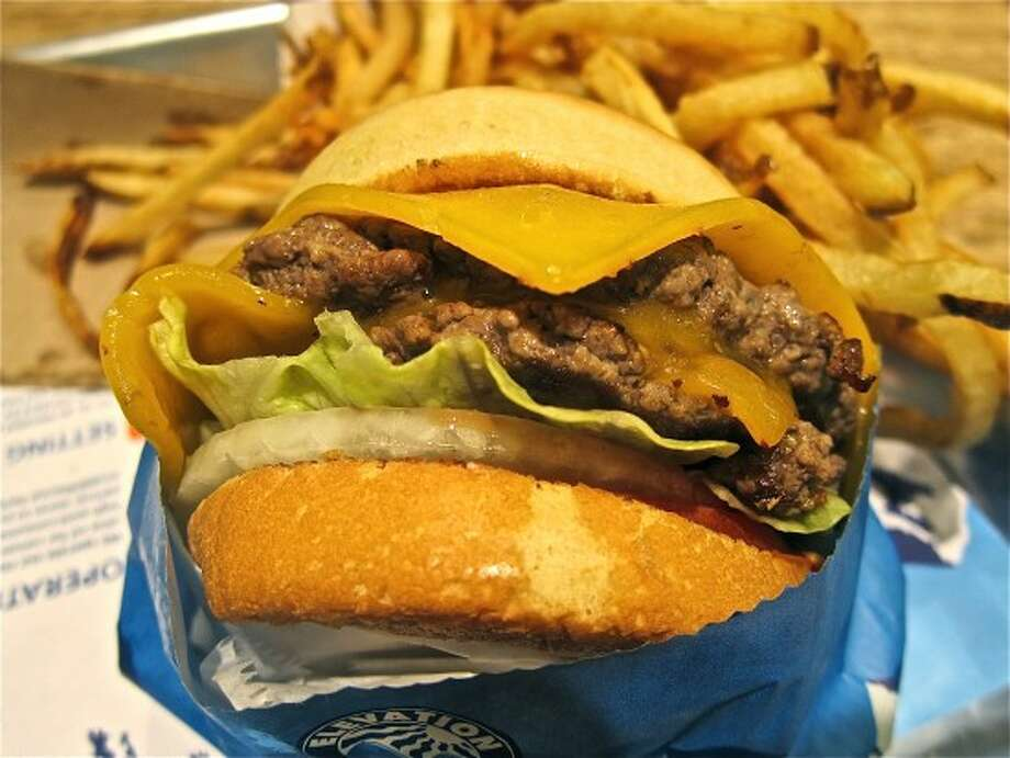 It's a build-your-own-burger proposition here, picking from the assorted condiments and vegetables on offer at Elevation Burger.  Grade: A Read Alison Cook's review. Photo: Alison Cook