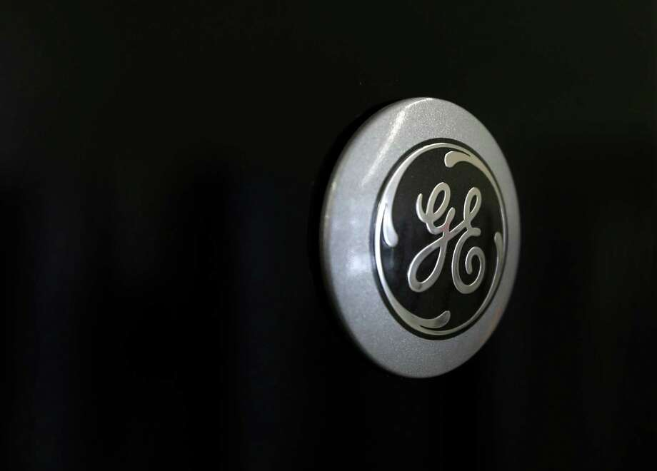 In this Tuesday, Feb. 26, 2013, photo, a General Electric logo is seen on a refrigerator at Green's, a furniture and appliance store, in Albany, N.Y. General Electric Co. reports quarterly financial results before the market opens on Friday, April 19, 2013. (AP Photo/Mike Groll) Photo: Mike Groll