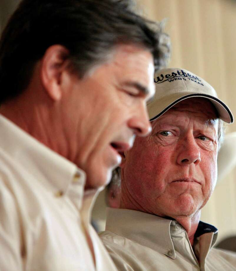 West Mayor Tommy Muska (right) listens to Gov. Rick Perry speak ,Friday April 19, 2013, during a press conference on an explosion at a fertilizer plant that occurred Wednesday evening in West, Tx. Photo: Edward A. Ornelas, San Antonio Express-News / © 2013 San Antonio Express-News