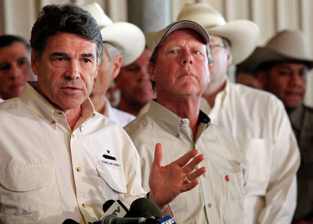 Gov. Rick Perry (left) speaks as West Mayor Tommy Muska listens,Friday April 19, 2013, during a press conference on an explosion at a fertilizer plant that occurred Wednesday evening in West, Tx. Photo: Edward A. Ornelas, San Antonio Express-News / © 2013 San Antonio Express-News