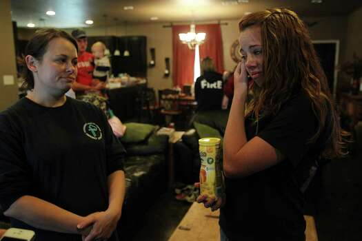 Bethany Raines comforts niece Dusty Uptmor, daughter of victim Buck Uptmor, while she talks about her father a day after the fertilizer plant explosion on Friday, April 19, 2013, in West. The explosion at the fertilizer plant killed 12 people and injured hundreds. Photo: Mayra Beltran, Houston Chronicle / © 2013 Houston Chronicle