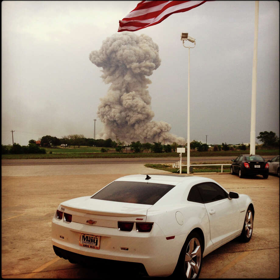 The mushroom cloud from the exlosion at the West Fertizer plant was photographed by an finance department employee at Greg May Chevrolet in West, Wednesday, April 17. Photo: Winslo Lopez, For The Express-News / San Antonio Express-News
