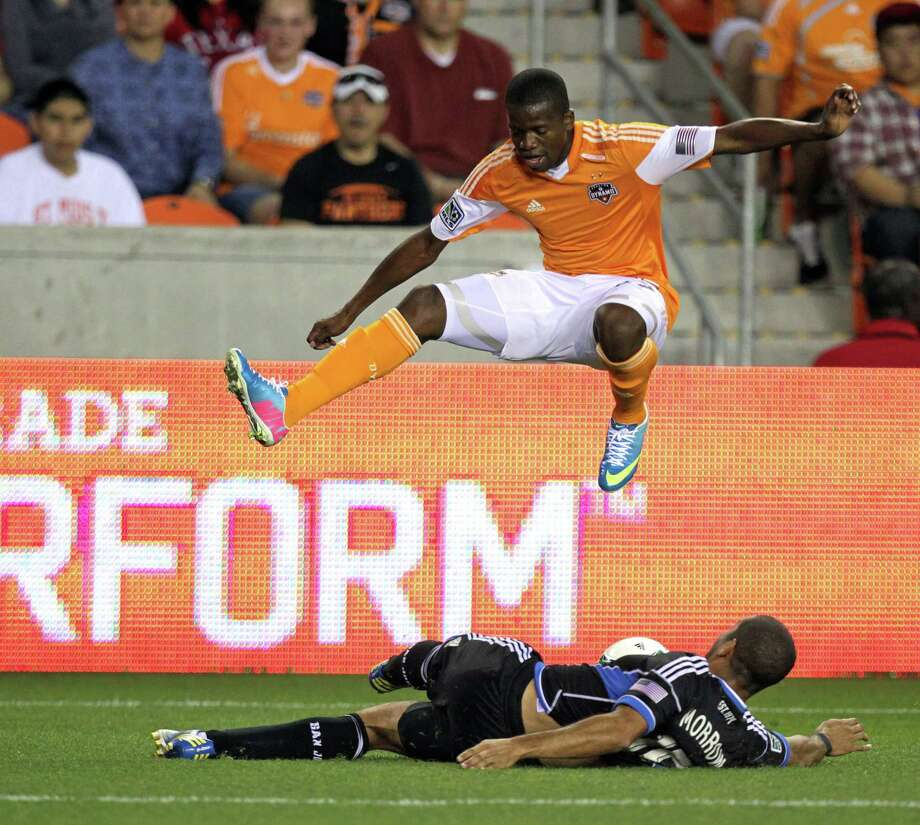 Midfielder Boniek Garcia, top, was voted the Dynamo's Most Valuable Player by teammates last season even though he played only half the matches. Photo: James Nielsen, Staff / © 2013 Houston Chronicle