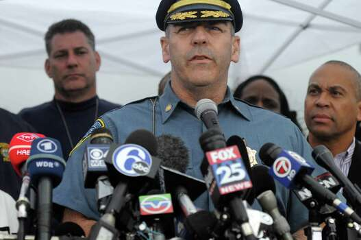 WATERTOWN, MA - APRIL 19: Massachusetts State Police Colonel Timothy Alben addresses the media April 19, 2013 in Watertown, Massachusetts. The lockdown of Watertown has been lifted after last nights shootout between police and the two Boston Marathon bombing suspects. After a car chase and shoot out with police, one suspect in the Boston Marathon bombing, Tamerlan Tsarnaev, 26, was shot and killed by police early morning April 19, and a manhunt is underway for his brother and second suspect, 19-year-old Dzhokhar A. Tsarnaev. The two men are suspects in the bombings at the Boston Marathon on April 15, that killed three people and wounded at least 170.  (Photo by Darren McCollester/Getty Images) Photo: Darren McCollester, Wire / 2013 Getty Images