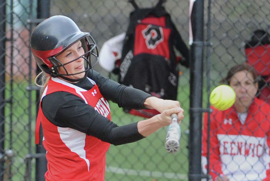 Rebecca DeCarlo of Greenwich hits a bases-clearing triple driving in 3 runs during the bottom of the fourth inning in the girls high school softball game between Greenwich High School and Wilton High School at Greenwich, Friday, April 19, 2013. Greenwich won the game 13-1 as Alison Kach of Greenwich pitched a 1-hitter. Photo: Bob Luckey / Greenwich Time