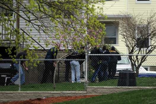 Law enforcement approach an area reportedly where a suspect is hiding on April 19, 2013 in Watertown, Massachusetts. After a car chase and shoot out with police, one suspect in the Boston Marathon bombing, Tamerlan Tsarnaev, 26, was shot and killed by police early morning April 19, and a manhunt is underway for his brother and second suspect, 19-year-old Dzhokhar A. Tsarnaev. The two men are suspects in the bombings at the Boston Marathon on April 15, that killed three people and wounded at least 170. Photo: Darren McCollester, Getty Images / 2013 Getty Images