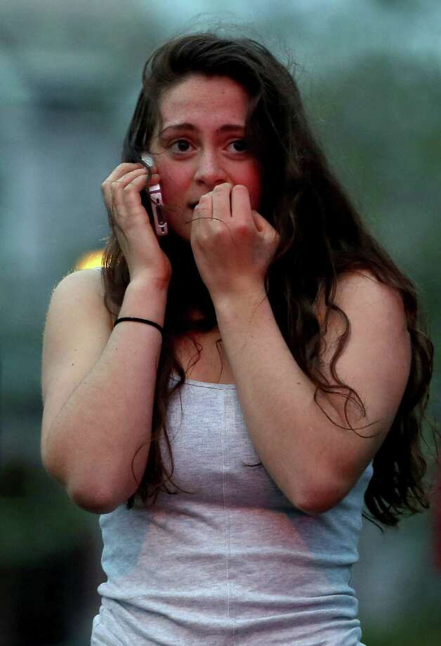 Resident Rosie Meyer, who said she heard gunshots, reacts while watching police respond on April 19, 2013 in Watertown, Massachusetts. After a car chase and shoot out with police, one suspect in the Boston Marathon bombing, Tamerlan Tsarnaev, 26, was shot and killed by police early morning April 19, and a manhunt is underway for his brother and second suspect, 19-year-old suspect Dzhokhar A. Tsarnaev. The two men, reportedly Chechen of origin, are suspects in the bombings at the Boston Marathon on April 15, that killed three people and wounded at least 170. Photo: Mario Tama, Getty Images / 2013 Getty Images