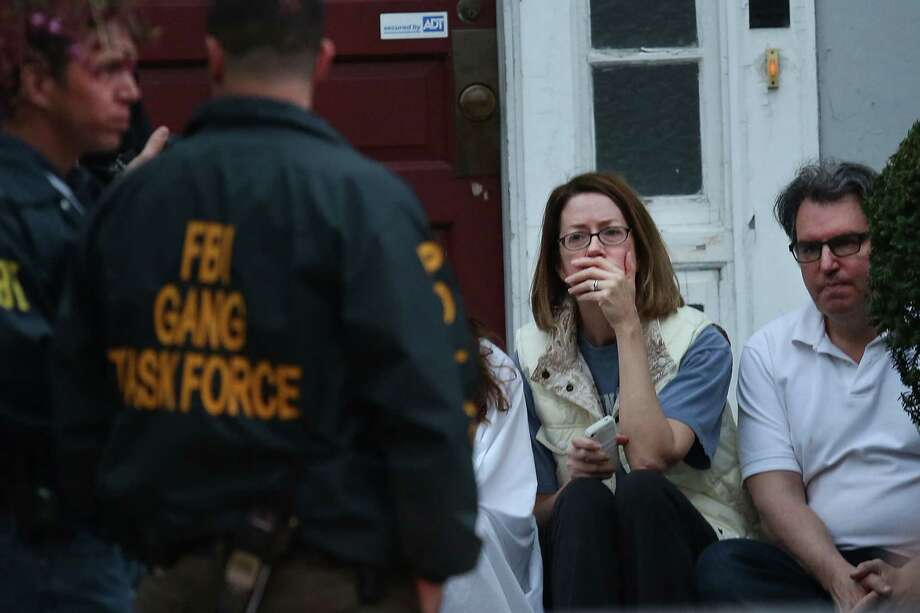 Family members who fled the scene where it was believed 19-year-old bombing suspect Dzhokhar A. Tsarnaev  is in hiding are comforted on April 19, 2013 in Watertown, Massachusetts. After a car chase and shoot out with police, one suspect in the Boston Marathon bombing, Tamerlan Tsarnaev, 26, was shot and killed by police early morning April 19, and a manhunt is underway for his brother and second suspect, 19-year-old suspect Dzhokhar A. Tsarnaev. The two men, reportedly of Chechen origin, are suspects in the bombings at the Boston Marathon on April 15, that killed three people and wounded at least 170. Photo: Spencer Platt, Getty Images / 2013 Getty Images