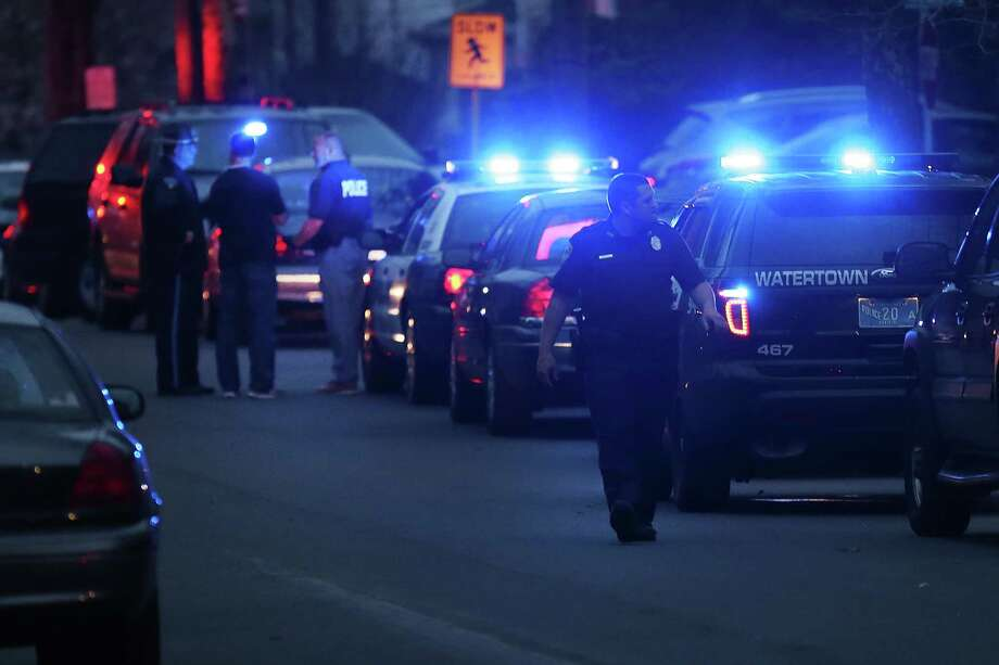 Police converge near the scene where it was believed 19-year-old bombing suspect Dzhokhar A. Tsarnaev  is in hiding on April 19, 2013 in Watertown, Massachusetts. After a car chase and shoot out with police, one suspect in the Boston Marathon bombing, Tamerlan Tsarnaev, 26, was shot and killed by police early morning April 19, and a manhunt is underway for his brother and second suspect, 19-year-old suspect Dzhokhar A. Tsarnaev. The two men, reportedly of Chechen origin, are suspects in the bombings at the Boston Marathon on April 15, that killed three people and wounded at least 170. Photo: Spencer Platt, Getty Images / 2013 Getty Images