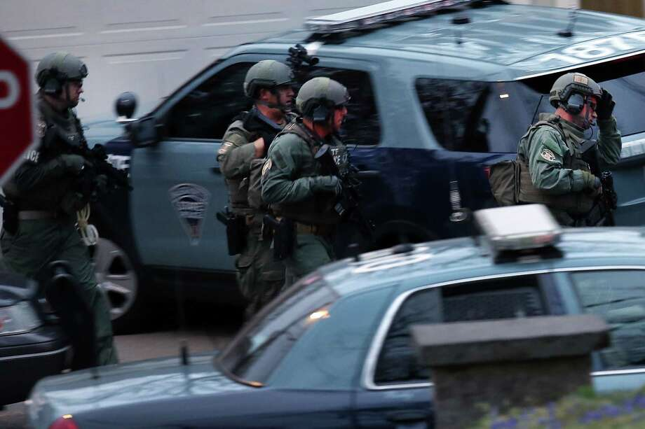 Members of a police S.W.A.T. team run to the area where it was believed 19-year-old bombing suspect Dzhokhar A. Tsarnaev  is hiding on April 19, 2013 in Watertown, Massachusetts. After a car chase and shoot out with police last night, one suspect in the Boston Marathon bombing, Tamerlan Tsarnaev, 26, was shot and killed by police early morning April 19, and a manhunt is underway for his brother and second suspect, 19-year-old suspect Dzhokhar A. Tsarnaev. The two men, reportedly of Chechen of origin, are suspects in the bombings at the Boston Marathon on April 15  that killed three people and wounded at least 170. Photo: Spencer Platt, Getty Images / 2013 Getty Images