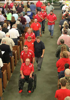 Members of West Volunteer Fire Department leave St. Mary's Catholic Church of the Assumption after a service honoring the department's fallen firefighters in West, Texas on Friday, Apr. 19, 2013. Five of the department's firefighters lost their lives in the West Fertilizer explosion on Wednesday. Photo: Kin Man Hui, San Antonio Express-News / ©2013 San Antonio Express-News