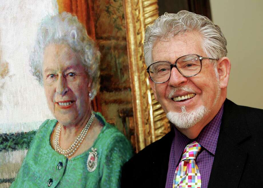 FILE - APRIL 19, 2013: The Sun tabloid newspaper in Britain is reporting that Australian entertainer, Rolf Harris was arrested in March, in relation to sex abuse claims. The Sun is claiming that Harris was arrested as a result of Operation Yewtree, the investigation into the Jimmy Savile sex abuse scandal.  LONDON - DECEMBER 19:  Artist Rolf Harris officially unveils his oil portrait of Queen Elizabeth II at The Queen's Gallery in Buckingham Palace on December 19, 2005 in London, England. Harris was permitted two sittings at Buckingham Palace, which were recorded for a BBC One documentary. More than 120 official portraits have been made of the Queen, by artists ranging from Dame Laura Knight to Lucien Freud.  (Photo by Chris Jackson/Getty Images) Photo: Chris Jackson, Staff / 2005 Getty Images