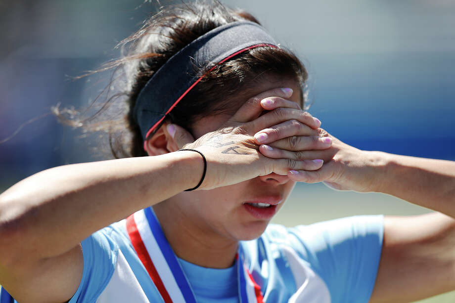 Johnson's Madison Amaro is overcome with emotion after losing the Class 5A girls state tournament semifinal against Southlake Carroll at Birkelbach Field in Georgetown on Friday, April 19, 2013. Southlake Carroll won 1-0. MICHAEL MILLER / FOR THE EXPRESS-NEWS Photo: Michael Miller, Express-News / For the Express-News