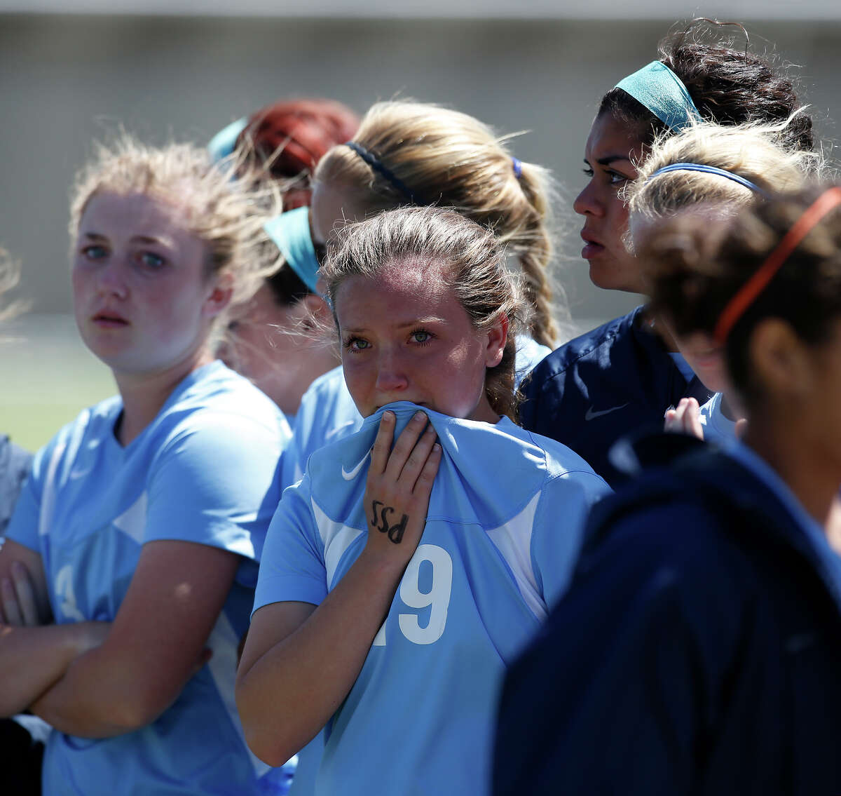 Johnson's Madison Gordon, center, tears up after losing the Class 5A girls state tournament semifinal against Southlake Carroll at Birkelbach Field in Georgetown on Friday, April 19, 2013. Southlake Carroll won 1-0. MICHAEL MILLER / FOR THE EXPRESS-NEWS