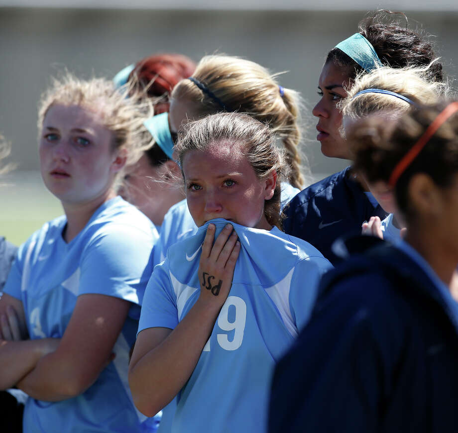Johnson's Madison Gordon, center, tears up after losing the Class 5A girls state tournament semifinal against Southlake Carroll at Birkelbach Field in Georgetown on Friday, April 19, 2013. Southlake Carroll won 1-0. MICHAEL MILLER / FOR THE EXPRESS-NEWS Photo: Michael Miller, Express-News / For the Express-News