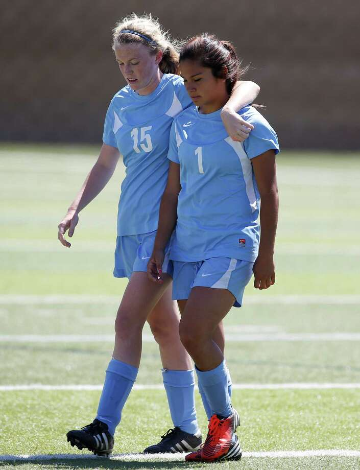 Johnson's Madelyn Carter, left, and Adriana Garcia walk off the field after the Class 5A girls state tournament semifinal at Birkelbach Field in Georgetown on Friday, April 19, 2013. Southlake Carroll won 1-0. MICHAEL MILLER / FOR THE EXPRESS-NEWS Photo: Michael Miller, Express-News / For the Express-News