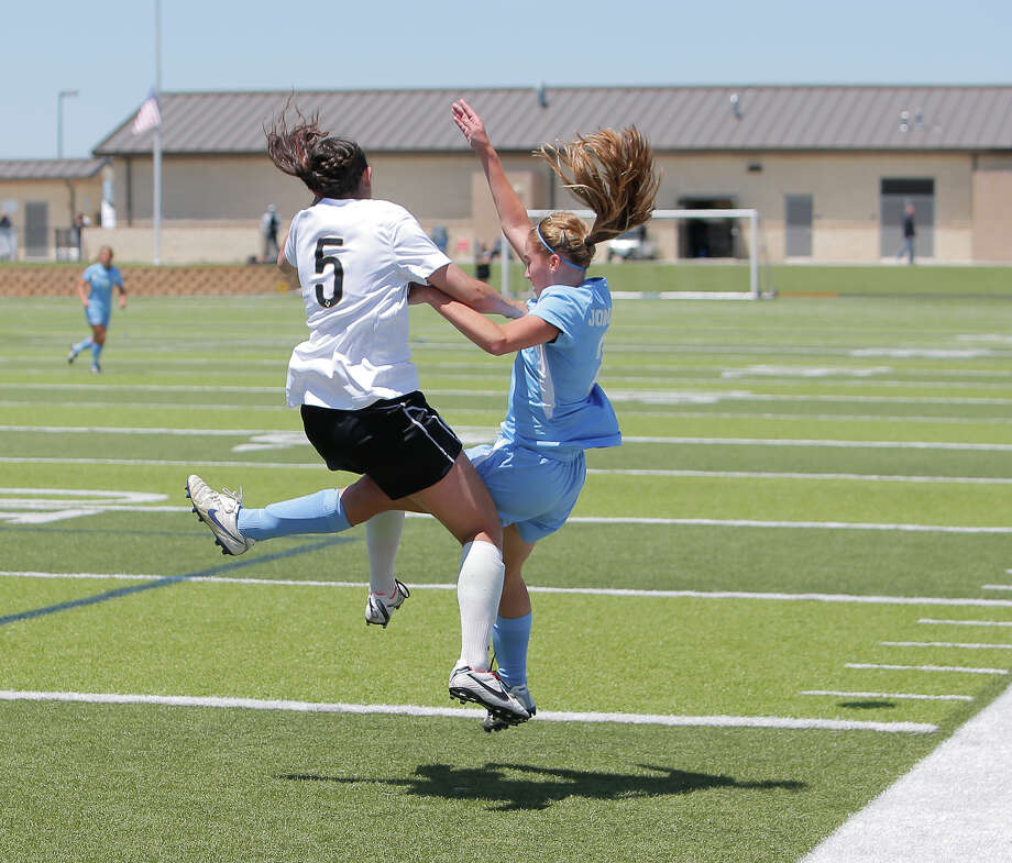 Southlake Carroll's Sophie Groff, left, collides with Johnson's Allison Parker after they both went for a header during game action of the Class 5A girls state tournament semifinal at Birkelbach Field in Georgetown on Friday, April 19, 2013. Southlake Carroll won 1-0. MICHAEL MILLER / FOR THE EXPRESS-NEWS Photo: Michael Miller, Express-News / For the Express-News