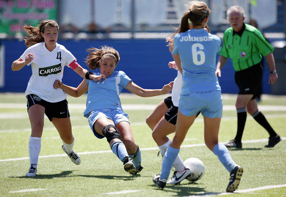 Johnson's Alyssa Clark (17) gets a shot off past Southlake Carroll's Julia Dyche during game action of the Class 5A girls state tournament semifinal at Birkelbach Field in Georgetown on Friday, April 19, 2013. Southlake Carroll won 1-0. MICHAEL MILLER / FOR THE EXPRESS-NEWS Photo: Michael Miller, Express-News / For the Express-News