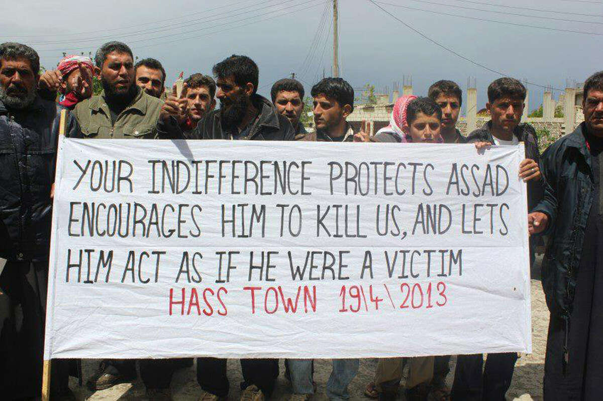 An authenticated citizen journalism image shows anti-government protesters during a demonstration in Hass Nabil in northern Syria.