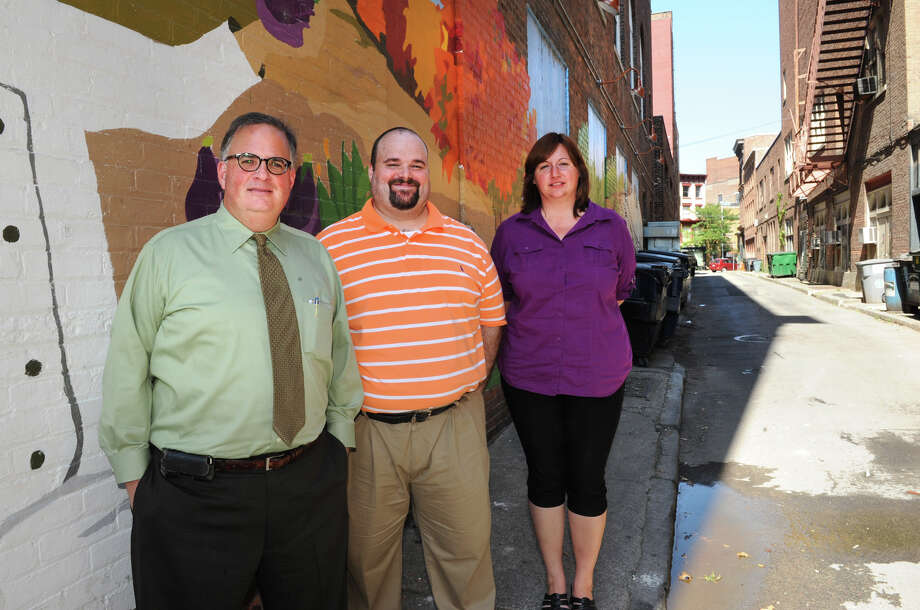 From left, Troy Planning Commissioner Bill Dunne, Charles Doyle, community development block grant outreach coordinator, and Dennee Zeigler, planning technician, stand in Franklin Alley Monday, Sept. 17, 2012 in Troy, N.Y. Dunne is is talking about transforming the alley into a pedestrian and dining area. (Lori Van Buren / Times Union) Photo: Lori Van Buren / 00019282A
