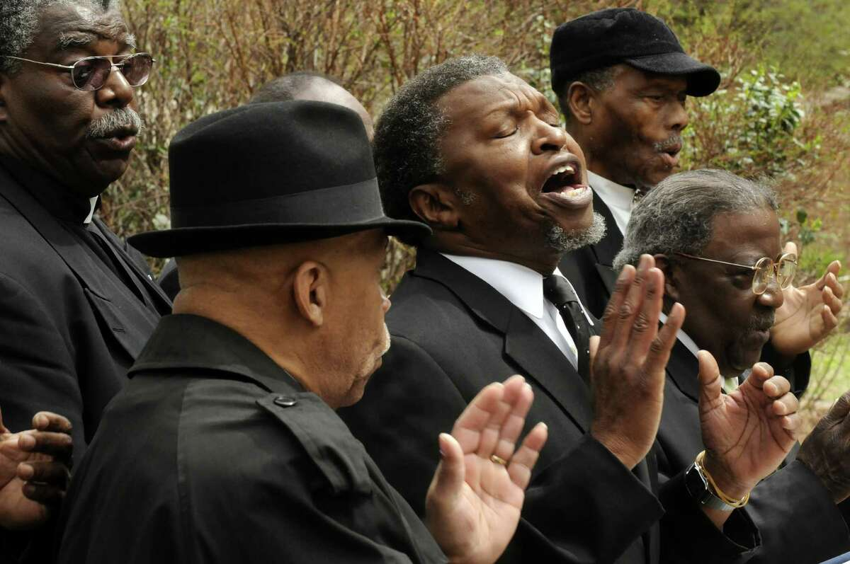 Members of the Mount Olive missionary Men's Choir perform during the New York State Crime Victims Memorial on Friday April 19, 2013 in Albany, N.Y. (Michael P. Farrell/Times Union)