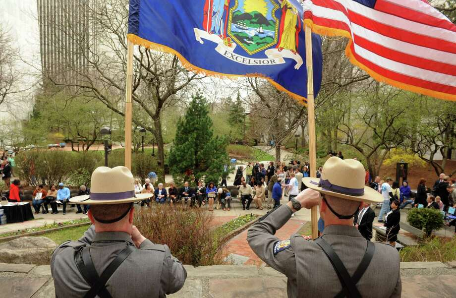 The New York State Police color guard post the colors during the New York State Crime Victims Memorial on Friday April 19, 2013 in Albany, N.Y. (Michael P. Farrell/Times Union) Photo: Michael P. Farrell