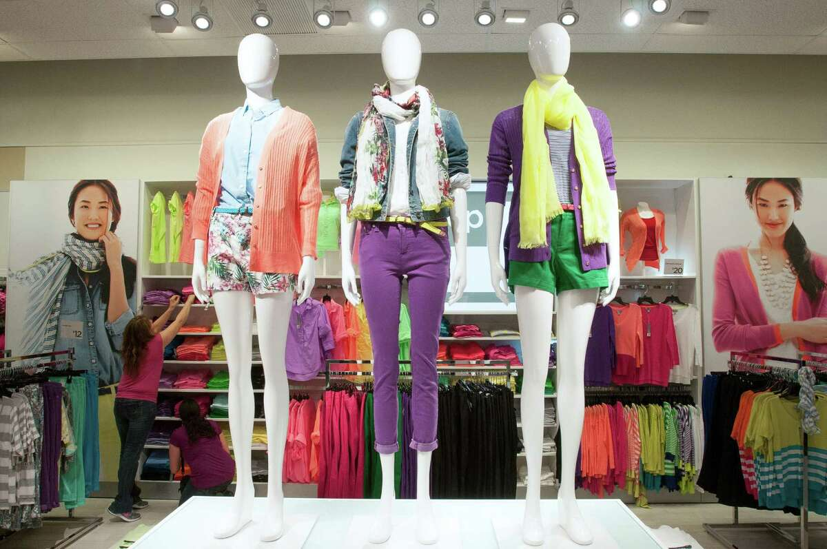 Mannequins dressed in women's clothing at a J.C. Penney store in Dallas, April 9, 2013. With the ouster of J.C. Penney's chief executive this week, the 111-year-old chain is scrambling to ensure that it has a future., and the solution may ultimately be a sale of some or all of the company. (Rex C. Curry/The New York Times)