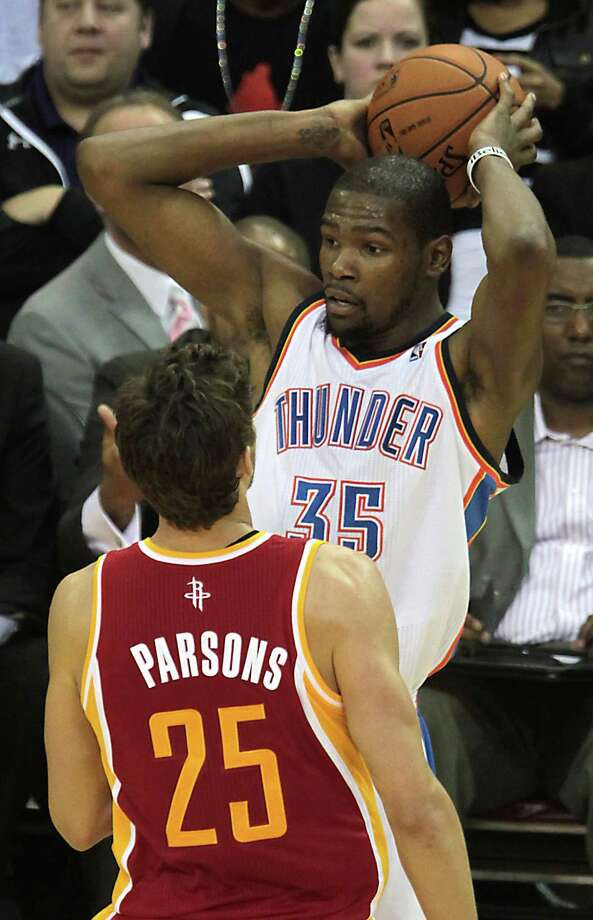 Kevin Durant, right, will be the main attraction in the Rockets' playoff series against the Thunder, but Chandler Parsons is aiming to limit his damage. Photo: James Nielsen, Staff / © 2013  Houston Chronicle