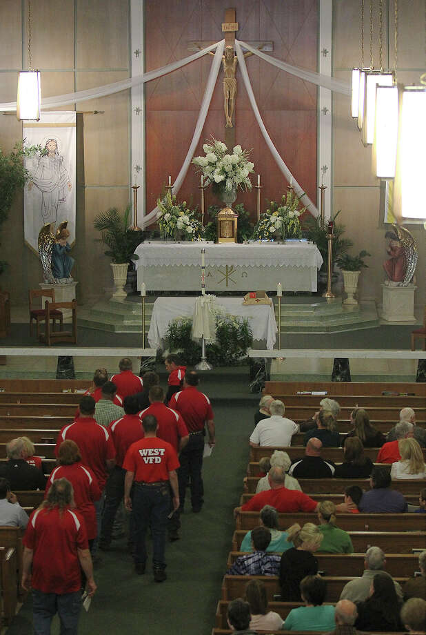 Members of West Volunteer Fire Department arrive at St. Mary's Catholic Church of the Assumption for a service honoring the department's fallen firefighters in West, Texas on Friday, Apr. 19, 2013. Five of the department's firefighters lost their lives in the West Fertilizer explosion on Wednesday. Photo: Kin Man Hui, San Antonio Express-News / ©2013 San Antonio Express-News